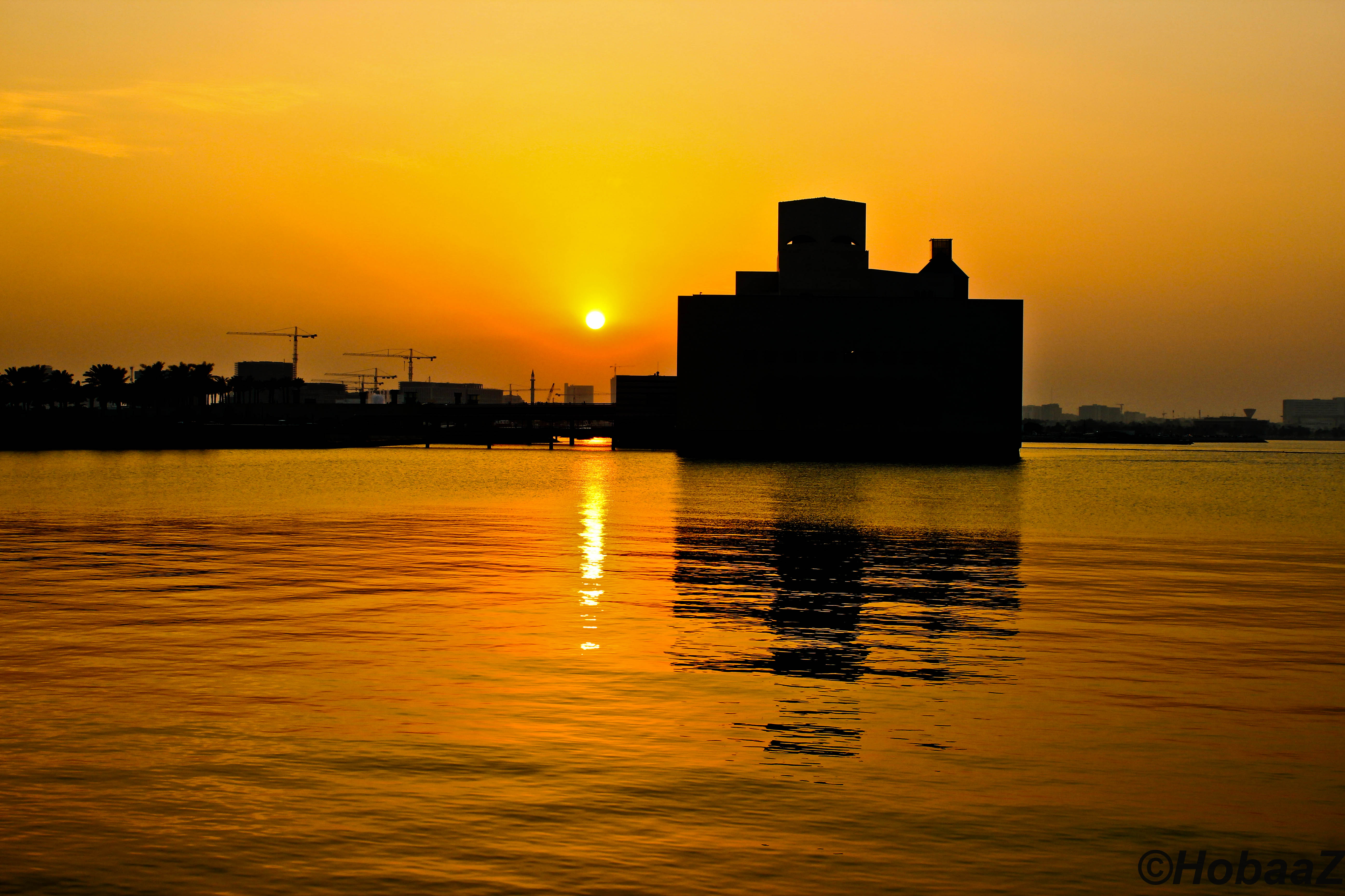 Sea and silhouette of buildings