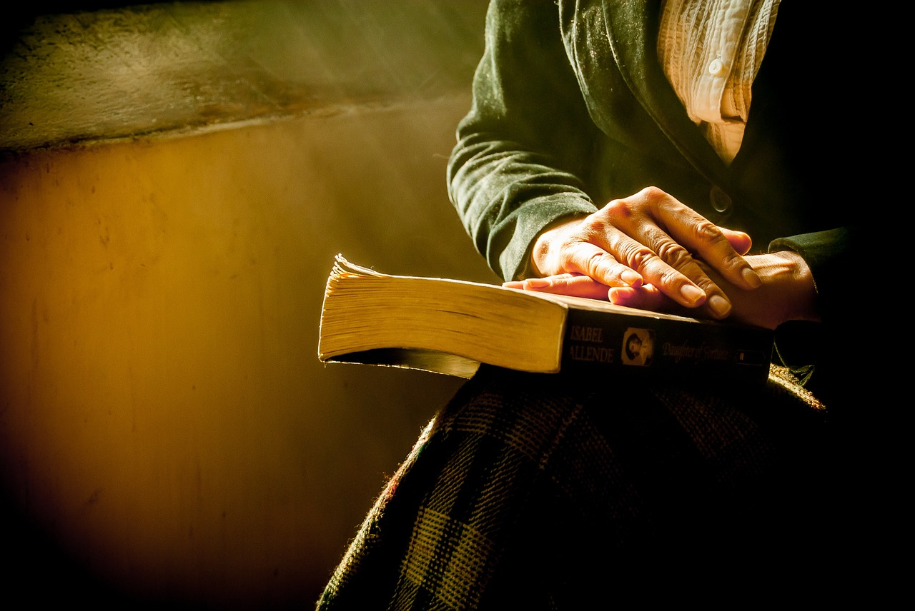 book and hands
