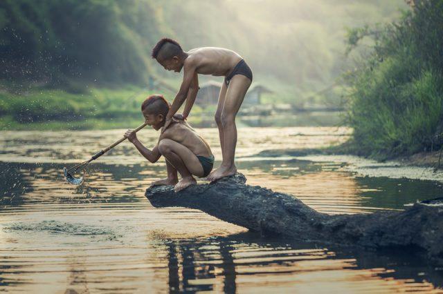 boys catching fish